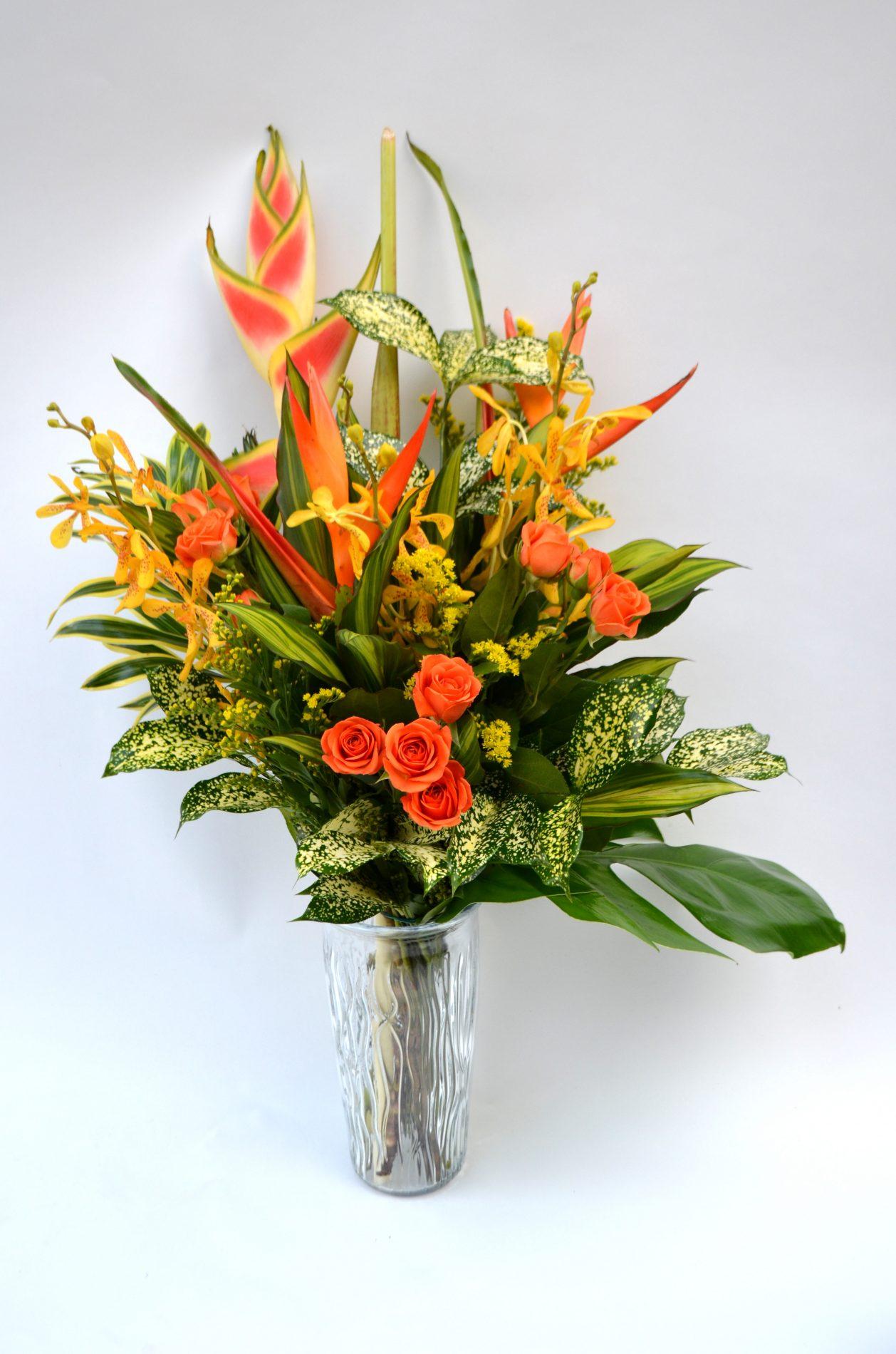 bouquet exotique extravagant avec heliconia et orchidées mokara